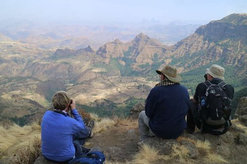 Three travellers looking out over the Simien Mountains, Ethiopia